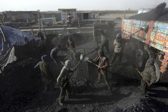 Afghan laborers work at a charcoal market in Dehsabz district of Kabul, Afghanistan Tuesday, December 5, 2017. (Photo by Rahmat Gul/AP Photo)