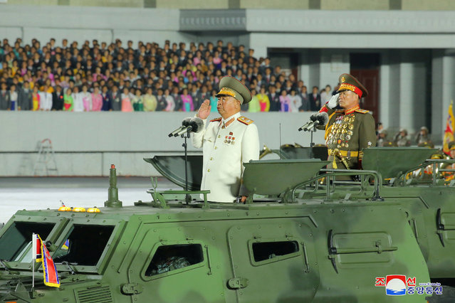 This picture taken on October 10, 2020 and released from North Korea's official Korean Central News Agency (KCNA) on October 11, 2020 shows North Korean Vice Chairman of the Central Military Commission Ri Pyong-chol (L) attending the military parade during a ceremony to mark the 75th anniversary of the Workers' Party of Korea at Kim Il-sung Square of Pyongyang. (Photo by KCNA via KNS/AFP Photo)