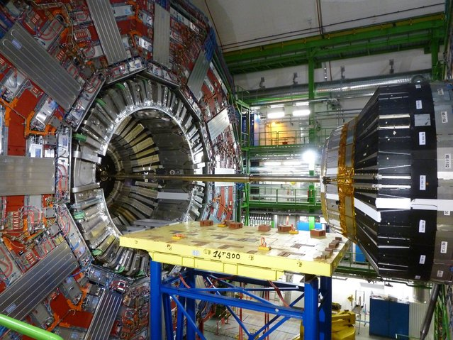 Previously unissued photo dated April 19, 2013 of a view of part of the CMS detector at the Large Hadron Collider, at the European Organization for Nuclear Research, known as CERN in Meyrin, Switzerland. Scientists are switching to the Dark Side as they prepare to ramp up the power at the Large Hadron Collider (LHC). After capturing a species of Higgs boson, the particle hunters now have their sights set on a new trophy – dark matter. A race is on between groups at the LHC, the world s biggest particle accelerator, and other scientists operating in space and deep underground who are chasing the same discovery. (Photo by John Von Radowitz/PA Wire)