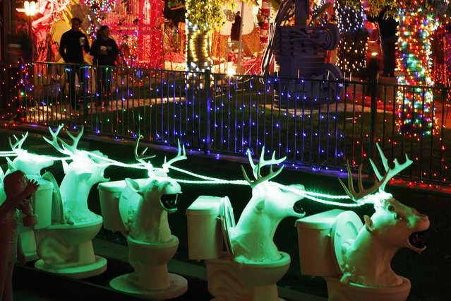 Santa Claus reindeer sculptures made with toilet bowls are seen at the Robolights art installation by Kenny Irwin Jr. in Palm Springs, California December 15, 2014. (Photo by David McNew/Reuters)