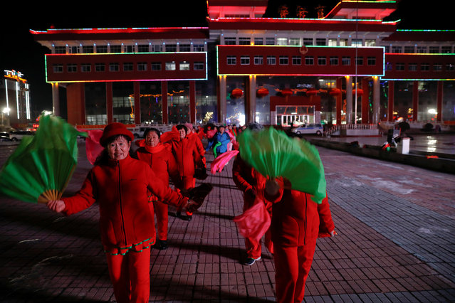 Women participate in a group dance exercise close to the Yalu River which runs between China and North Korea, in the town of Linjiang in Jilin province, China, November 21, 2017. (Photo by Damir Sagolj/Reuters)