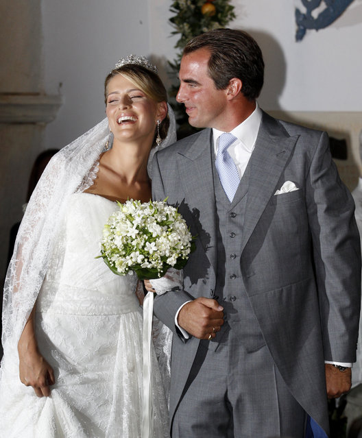 Prince Nikolaos, son of Greece's deposed King Constantine, and his bride Tatiana Blatnik leave Agios Nikolaos church after their wedding ceremony on the island of Spetses, August 25, 2010. (Photo by Yiorgos Karahalis/Reuters)
