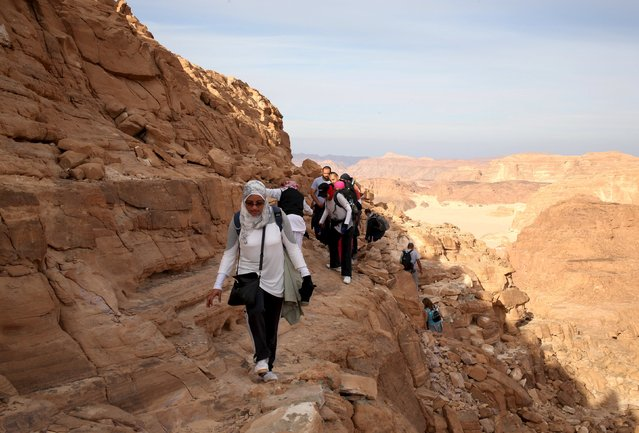 Hikers walk to reach the top of Naqba Rum area in South Sinai, Egypt, November 20, 2015. (Photo by Asmaa Waguih/Reuters)