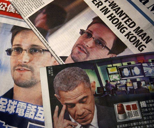 Photos of Edward Snowden, a contractor at the National Security Agency (NSA), and U.S. President Barack Obama are printed on the front pages of local English and Chinese newspapers in Hong Kong in this illustration photo June 11, 2013. Snowden, who leaked details of top-secret U.S. surveillance programs, dropped out of sight in Hong Kong on Monday ahead of a likely push by the U.S. government to have him sent back to the United States to face charges. (Photo by Bobby Yip/Reuters)