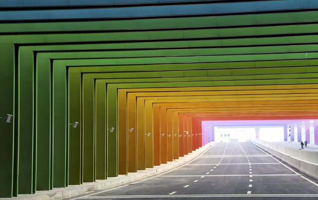 A newly-built tunnel, consisting of rainbow colours, in Zhengzhou, Henan province January 13, 2015. (Photo by Reuters/Stringer)