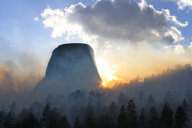 """Smoke at Sunset"". Taken durning Belle Fouche Prescribed burn at Devils Tower National Monument. Location: Devils Tower NM, WYoming. (Photo and caption by Drew Gilmour/National Geographic Traveler Photo Contest)"
