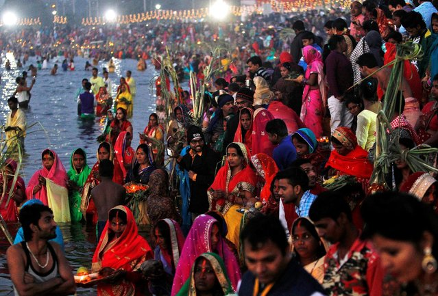 Hindu devotees gather to worship the Sun God on the banks of the Sun Lake during the religious festival of Chhat Puja in Chandigarh, India, November 7, 2016. (Photo by Ajay Verma/Reuters)