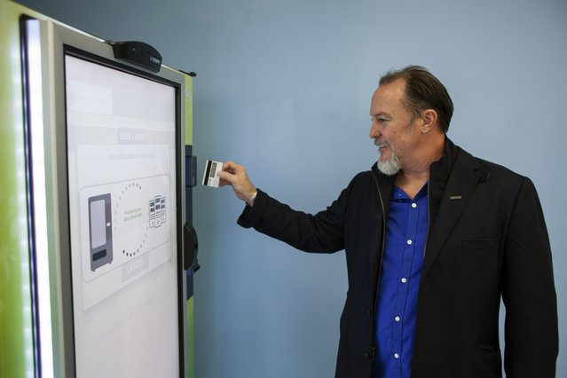 Stephen Shearin demonstrates the use of a ZaZZZ vending machine that contains cannabis flower, hemp-oil energy drinks, and other merchandise at Seattle Caregivers, a medical marijuana dispensary, in Seattle, Washington February 3, 2015. (Photo by David Ryder/Reuters)