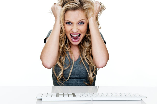 Woman frustrated using a computer. (Photo by Getty Images/Vetta/Stockphoto4u)