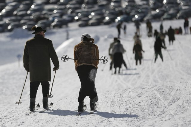 "Participants compete in the ""Nostalgic Ski Race"" in the western town of Neuastenberg February 8, 2015. (Photo by Ina Fassbender/Reuters)"