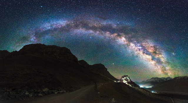 Key Monastery illuminated on a mountain in the Spiti Valley, Himachal Pradesh, northern India photographed with the full Milky Way on show. (Photo by Grey Chow/Caters News Agency)