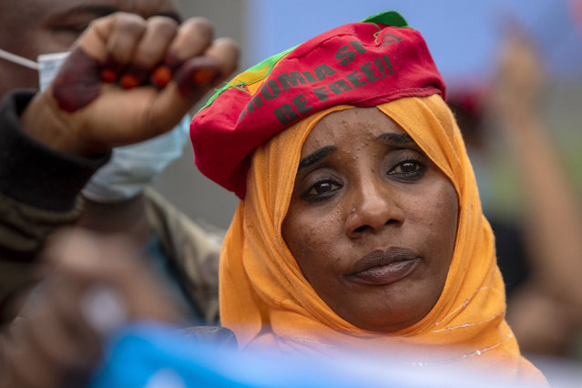 A member of Oromia community raises her fist during a protest against the conflict in the Ethiopia's Tigray region, outside the European Union offices in Pretoria, South Africa, Thursday, March 25, 2021. (Photo by Themba Hadebe/AP Photo)