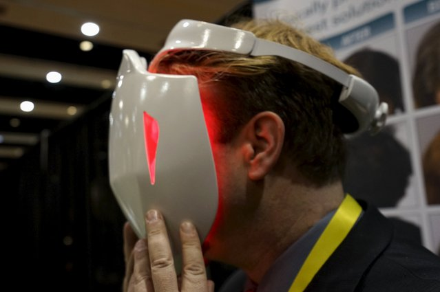 Jonathan Graff, director of clinical research for Apira Science demonstrates the company's iDerma Facial Beautification System, that is designed to treat various skin-related disorders, at the Consumer Electronics Show in Las Vegas January 4, 2016. (Photo by Rick Wilking/Reuters)