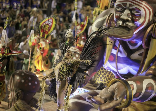 A reveler from the Imperatriz Leopoldinense samba school participates in the annual carnival parade in Rio de Janeiro's Sambadrome February 17, 2015. (Photo by Ricardo Moraes/Reuters)