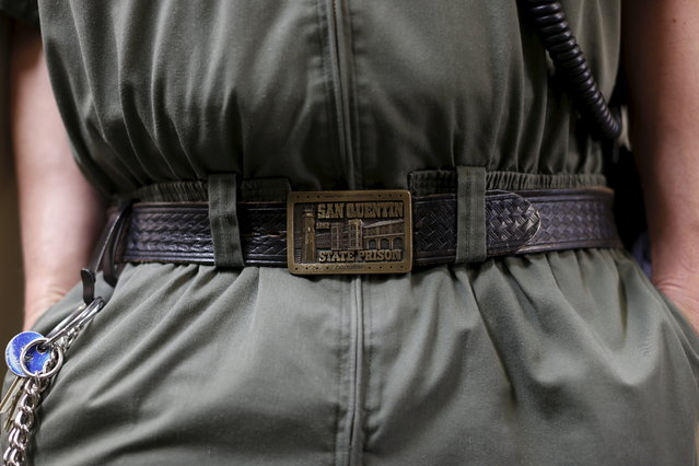 A guard displays his San Quentin State Prison belt buckle during a media tour of California's Death Row at San Quentin State Prison in San Quentin, California December 29, 2015. (Photo by Stephen Lam/Reuters)