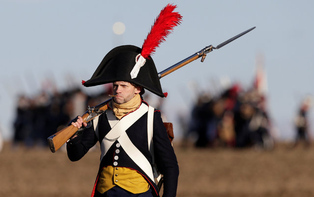 A history enthusiast, dressed as a soldier, marches before the re-enactment of Napoleon's famous battle of Austerlitz near the southern Moravian town of Slavkov u Brna, Czech Republic December 3, 2016. (Photo by David W. Cerny/Reuters)