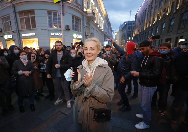 People applaud Yulia Navalnaya, the wife of the Russian jailed opposition leader Alexei Navalny, during an opposition rally in Moscow, Russia, 21 April 2021. Unauthorized rallies in support of Alexei Navalny are expected to be held throughout Russia. Russian opposition leader Alexei Navalny has been transferred from the penal colony No. 2 (IK-2) in Pokrov, Vladimir region, to the regional prison hospital in IK-3 in Vladimir for receiving vitamin therapy. The decision was taken amid Navalny's hunger strike and announced by his team members fearing for his life. (Photo by Sergei Ilnitsky/EPA/EFE)