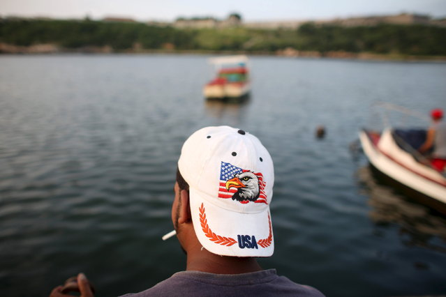 Fisherman Rene Lopez, 29, fishes at the canal of Havana's bay in Havana, July 31, 2015. (Photo by Alexandre Meneghini/Reuters)