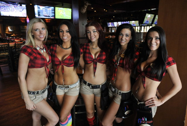 Servers at Twin Peaks restaurant in Wheeling, Il. on Thursday, October 3, 2013. Twin Peaks is one of the new wave of  that have been growing rapidly the last few years, in part at the expense of Hooters, which is still the biggest in the category, but has been struggling somewhat. Twin Peaks and rival Tilted Kilt dress their waitresses in even skimpier outfits than Hooters – short shorts, bare midriffs and big emphasis on cleavage. A restaurant-industry veteran recently bought the rights to open franchised Twin Peaks locations in the Milwaukee area and is currently scouting local real estate. (Photo by Paul Beaty/Journal Sentinel)