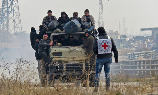 Syrians are evacuated from a rebel-held area of Aleppo towards rebel-held territory in the west of Aleppo's province on December 16, 2016. Russia announced it was negotiating with the Syrian opposition and seeking a nationwide ceasefire, as the evacuation of civilians and fighters from the last rebel-held parts of Aleppo entered a second day. The Syrian Observatory for Human Rights, a Britain-based monitor of the war, estimated some 8,500 people had left so far, including around 3,000 rebel fighters. Syrian state media reported a figure of around 8,000. (Photo by AFP Photo/Stringer)