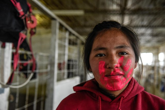Michelle Whitehorse from the Navajo Nation paints her face before participating in an Indian relay race over Memorial Day weekend at the Osage County Fairgrounds in Pawhuska, Oklahoma, U.S. May 31, 2021. (Photo by Stephanie Keith/Reuters)