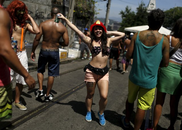 "A reveller takes part in an annual block party known as ""Ceu na Terra"" (Heaven on Earth), one of the many carnival parties to take place in the neighbourhoods of Rio de Janeiro, January 30, 2016. (Photo by Pilar Olivares/Reuters)"