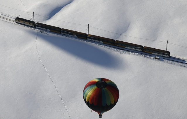 SWITZERLAND: A balloon flies during the 38th International Hot Air Balloon Week in Chateau-d'Oex, Switzerland January 23, 2016. For nine days balloonists from 15 countries take part in the ballooning event in the Swiss mountain resort famous for ideal flight conditions due to an exceptional microclimate. (Photo by Denis Balibouse/Reuters)