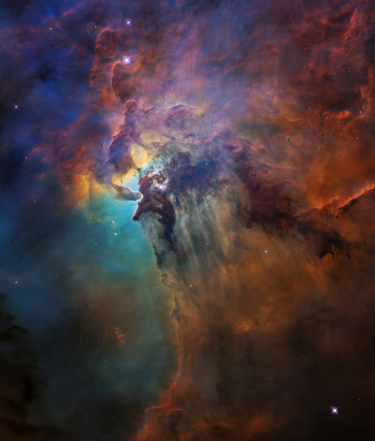 Ultraviolet radiation and stellar winds from a giant star called Herschel 36 push through dust in curtain-like sheets in the Lagoon Nebula stellar nursery, located 4,000 light years away, in this Hubble Space Telescope image obtained September 26, 2018. (Photo by NASA/ESA/STScI/Handout via Reuters)