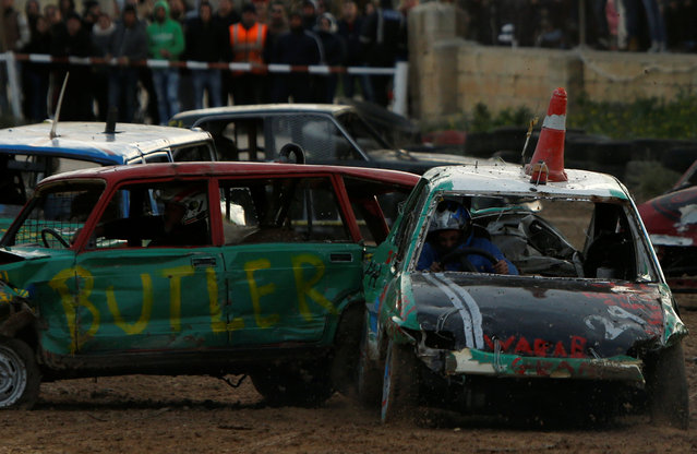 Drivers take part in a demolition derby organised by the Malta Motor Sports Association to raise funds for charity in Ta' Qali, outside Valletta, Malta, January 8, 2017. (Photo by Darrin Zammit Lupi/Reuters)