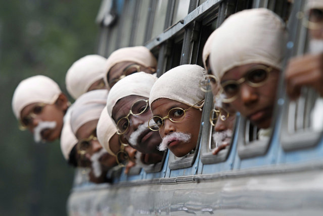Children dressed as Mahatma Gandhi arrive on a bus to take part in a peace march in Kolkata, January 29, 2012. (Photo by Rupak De Chowdhuri/Reuters)