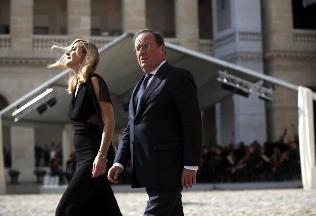 Former French President Francois Hollande and actress Julie Gayet arrive for a tribute ceremony for his father French actor Jean-Paul Belmondo at the Hotel des Invalides, Thursday, September 9 2021 in Paris. France is paying respects Thursday to screen legend Jean-Paul Belmondo with a solemn ceremony led by the president and a public viewing at Napoleon's final resting place. (Photo by Ian Langsdon/Pool Photo via AP Photo)