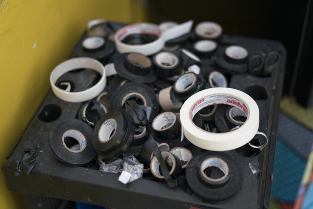 In this January 11, 2017 photo, rolls of electrical tape used to create custom bikinis, which offer crisp tan lines, sit at the Erika Bronze rooftop salon in the suburb of Realengo in Rio de Janeiro, Brazil. While pulling it off would normally hurt, temperatures close to 100 degrees Fahrenheit (40 Celsius) ensure plenty of sweat and a smooth removal. (Photo by Renata Brito/AP Photo)
