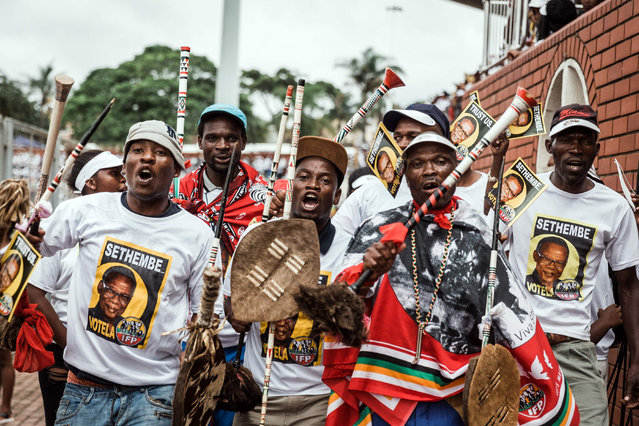 Inkatha Freedom Party (IFP) members dressed in traditional attire sing and dance at the Inkatha Freedom Party (IFP) elections manifesto launch at The Chatsworth Stadium, outside the city of Durban on March 10, 2019. South Africans will go to the polls on May 8, 2019 to elect a new National Assembly and new provincial legislatures. (Photo by Rajesh Jantilal/AFP Photo)