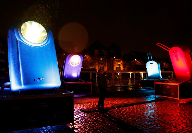 A man takes pictures of giant flashlights displayed along the Brussels' canal district during the Bright Brussels Festival, Belgium, February 4, 2017. (Photo by Francois Lenoir/Reuters)