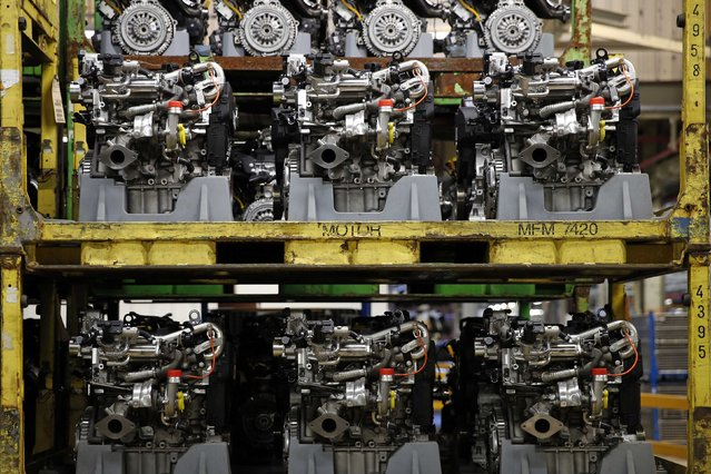 Engines are seen on the automobile assembly line for the Renault Clio IV at the Renault automobile factory in Flins, west of Paris, France, May 5, 2015. (Photo by Benoit Tessier/Reuters)