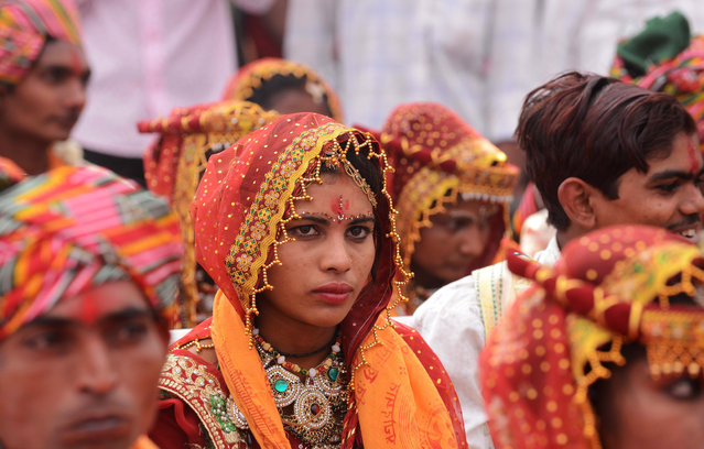 An Indian bride looks on during a mass-wedding ceremony for members of the Thakore community at Bhuvaldi village on the outskirts of Ahmedabad on February 3, 2017. (Photo by Sam Panthaky/AFP Photo)
