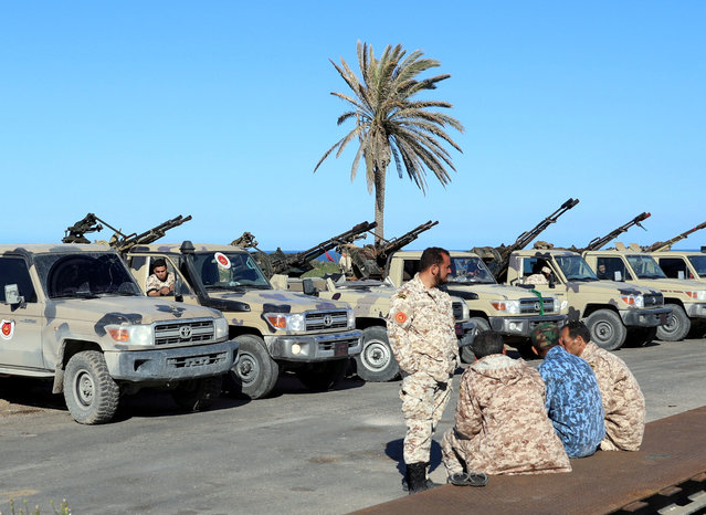 Military vehicles of Misrata forces, under the protection of Tripoli's forces, are seen in Tajura neighborhood, east of Tripoli, Libya April 6, 2019. (Photo by Hani Amara/Reuters)