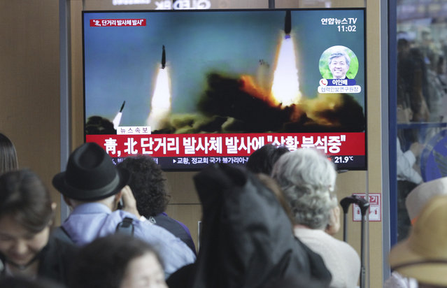 """People watch a TV showing a file footage of North Korea's missile launch during a news program at the Seoul Railway Station in Seoul, South Korea, Saturday, May 4, 2019. North Korea on Saturday fired several unidentified short-range projectiles into the sea off its eastern coast, the South Korean Joint Chiefs of Staff said, a likely sign of Pyongyang's growing frustration at stalled diplomatic talks with Washington meant to provide coveted sanctions relief in return for nuclear disarmament. The signs read: """"North Korea fired short-range missiles"""". (Photo by Ahn Young-joon/AP Photo)"""