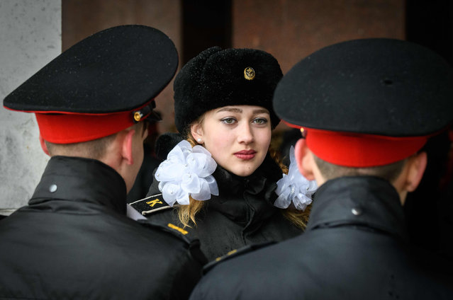 A Russian female cadet talks to her schoolmates during the annual cadet schools get-together in Moscow on March 29, 2019. (Photo by Mladen Antonov/AFP Photo)