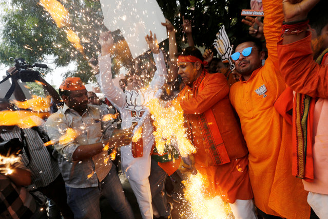 BJP supporters celebrate after learning the initial election results outside the party headquarters in New Delhi, India, May 23, 2019. (Photo by Adnan Abidi/Reuters)