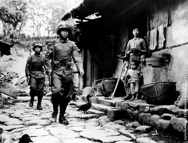 The Americans retain a close relationship with the Chinese Nationalist government by providing qualified military instructors for troop training. Here Chinese soldiers can be seen on manoeuvres near Chiay-i