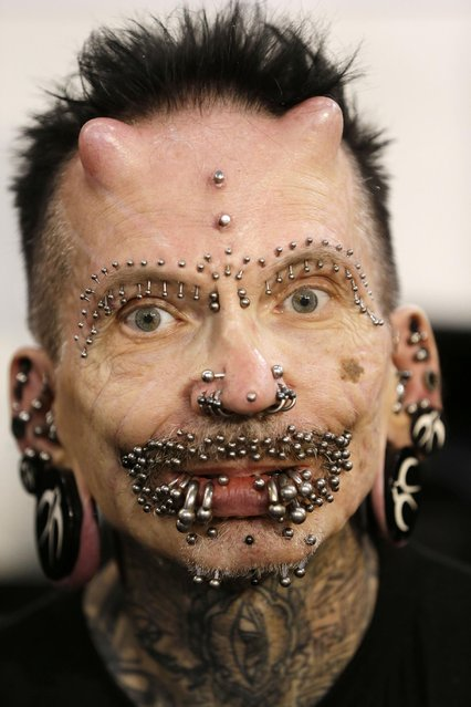 Rolf Buchholz, 56, poses for a photograph during the annual Athens Tattoo Convention in Athens, Sunday, May 17, 2015. Buchholz, an information technology professional from Dortmund, Germany has 453 piercings and is the holder of a Guinness World Record. (Photo by Thanassis Stavrakis/AP Photo)