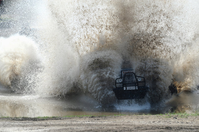 A participant attends a regionaltractorracing competition Bizon-Track-Show outside of Rostov-on-Don, Russia on June 2,  2019. (Photo by SergeyPivovarov/Reuters)
