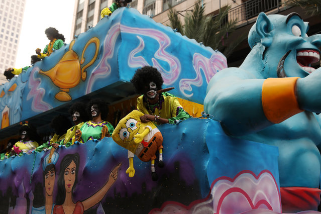 Float riders look out at the crowd during the Krewe of Zulu parade during Mardi Gras in New Orleans, Louisiana U.S., February 28, 2017. (Photo by Shannon Stapleton/Reuters)