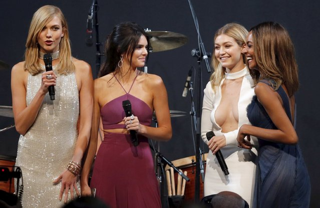 U.S. models Karlie Kloss, Kendall Jenner, Gigi Hadid and British model Jourdan Dunn conduct an auction during the amfAR's Cinema Against AIDS 2015 event during the 68th Cannes Film Festival in Antibes, near Cannes, southern France, May 21, 2015. (Photo by Regis Duvignau/Reuters)