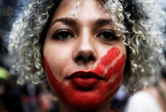 A demonstrator takes part in a march on International Women's Day in Sao Paulo, Brazil, March 8, 2017. (Photo by Nacho Doce/Reuters)