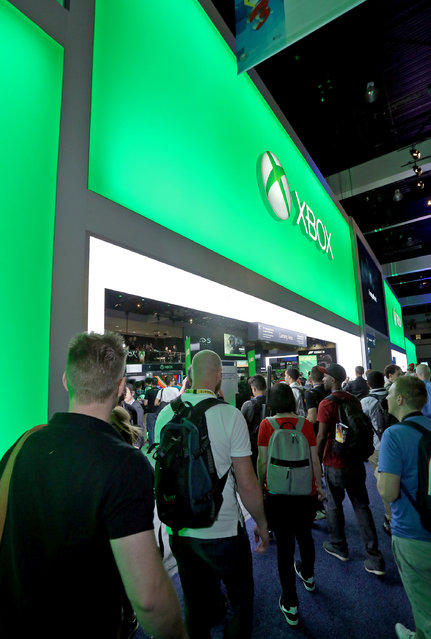 E3 2015 attendees enter the Xbox booth at E3 in Los Angeles on Tuesday, June 16, 2015. (Photo by Casey Rodgers/Invision for Microsoft/AP Images)