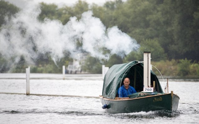 The steamboat Naiad makes her way along the river Thames during day one of the Thames Traditional Boat Festival in Henley-on-Thames, England on July 19, 2019. (Photo by Andrew Matthews/PA Images via Getty Images)
