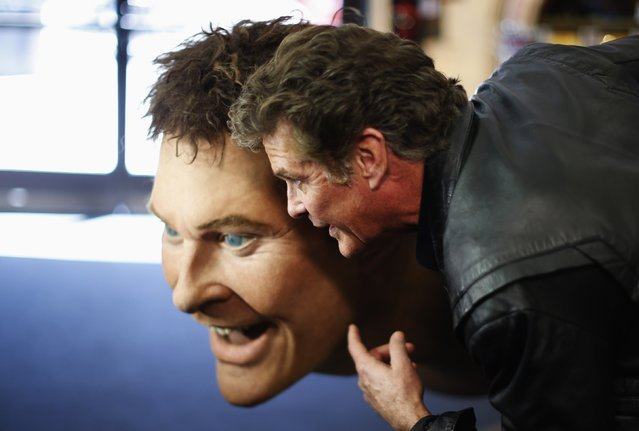"""Actor David Hasselhoff poses with a replica of himself built for the """"The SpongeBob SquarePants Movie"""", during an auction in Beverly Hills, California April 7, 2014. (Photo by Lucy Nicholson/Reuters)"""