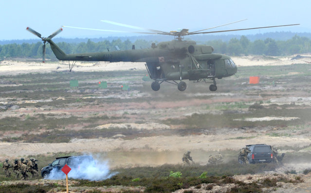 A Polish Army helicopter supports soldiers during the NATO Noble Jump exercise on a training range near Swietoszow Zagan, Poland, Thursday, June 18, 2015. (AP Photo/Alik Keplicz)